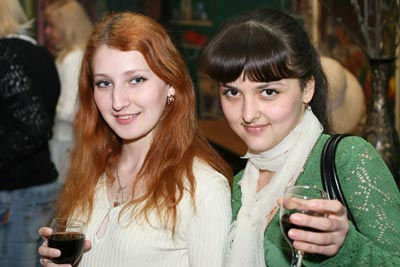 A photo of two beautiful Russian women, each holding a glass of wine